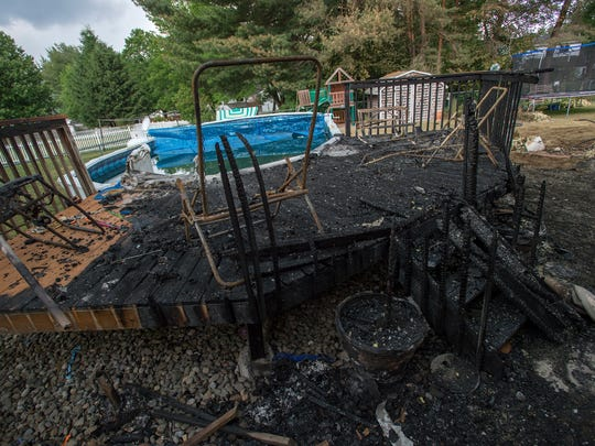 A burnt portion of a pool deck in the backyard of 451 Leon Drive in West Corners after a fire tore through the backyard and portion of the house on Sunday.