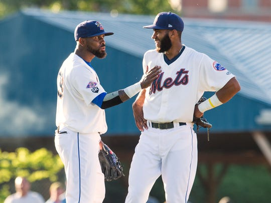Jose Reyes, left, and Amed Rosario share a laugh during
