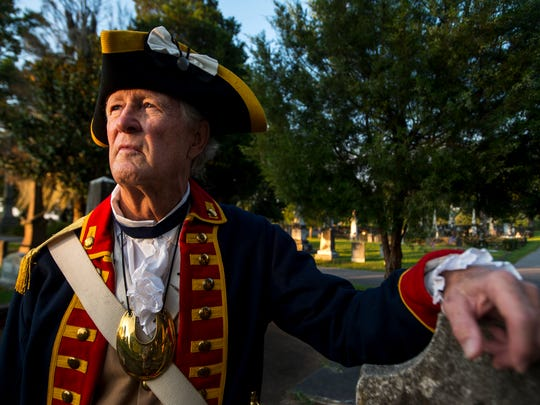 Larry Cornwell poses for a portrait next to the grave of Rev. George Gray McWhorter, who fought in the Revolutionary War, on Thursday, Jun. 30, 2016 at Oakwood Cemetery in Montgomery, Ala. Cornwell is the Genealogist General for the Sons of the American Revolution, and has located six graves of Revolutionary War patriots buried in Montgomery.