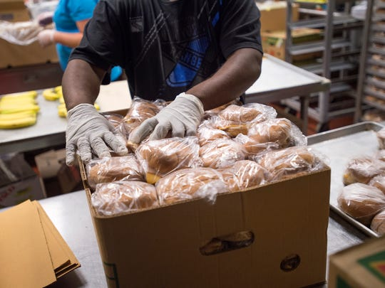 Ready-made sandwiches are packaged for children at