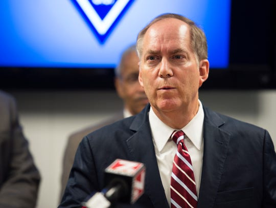 Greenville Mayor Knox White speaks during a press conference