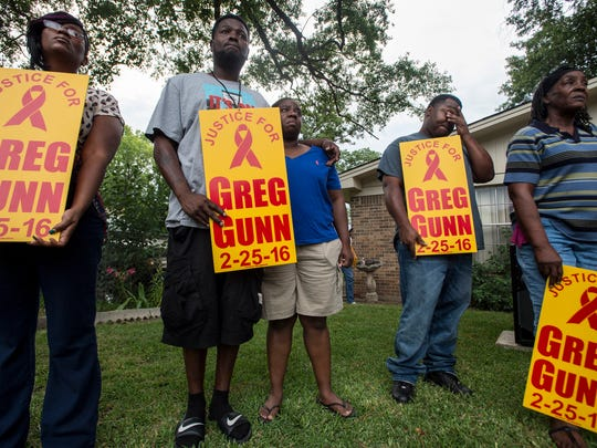 Friends and family gather during a vigil for Greg Gunn in his Mobile Heights neighborhood on Sunday, July 10, 2016. Gunn was shot and killed by Aaron C. Smith, a 23-year-old Montgomery police officer who was indicted on a murder charge.