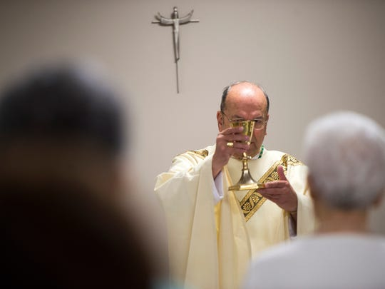 "Bishop Robert Cunningham, of the Syracuse Catholic Diocese, leads a ""Year of Mercy"" Mass at Catholic Charities of Broome County in Binghamton."