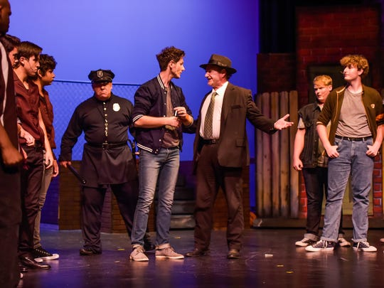 """Actors from Christian Community Theatre of Lafayette rehearse a scene from  """"West Side Story."""" at Burke Hall Auditorium stage on the UL campus."""