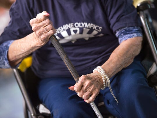 Jean Breuche, 96, grips her putter while competing in the annual Sunshine Olympics at the United Methodist Homes Hilltop Campus in Johnson City on Wednesday.