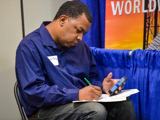 Mondrell Phillips fills out application at the Cumulus Acadiana Career Expo at Wyndham Garden Lafayette featured a variety of employers in the Acadiana area.