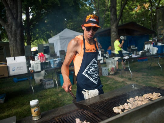 Charles Williams, of Binghamton, cooks chicken for spiedies at the Salamida Spiedies tent during the first day of Spiedie Fest on Friday.