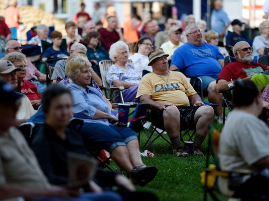 Fans kick back and enjoy King's Highway during Bluegrass in the Park Folklife Festival last year.