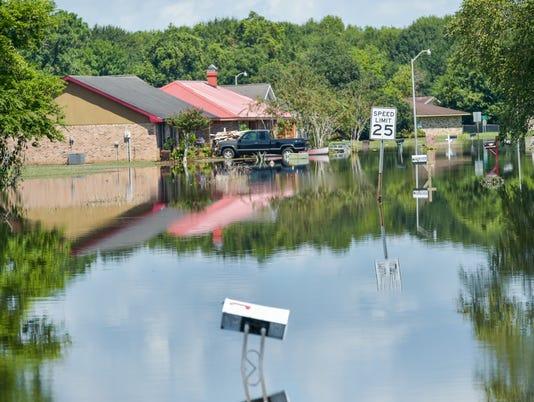 636074725013220252-tda.Carmel.drive.flood.water.08.22-3210.jpg