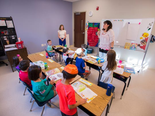 Mrs. Putney's first-grade class works in their new classroom Wednesday on the first day of school at Temple Israel.