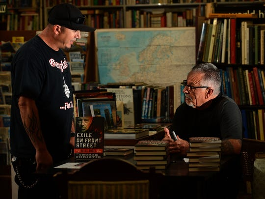 Sal Sorbello (left) meets George Christie at a book signing Tuesday in Ventura.