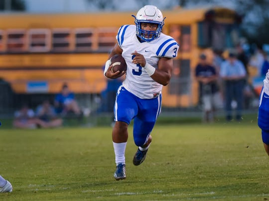Erath's Elijah Mitchell runs the ball in the open field during his 259-yard performance at North Vermilion on Thursday.