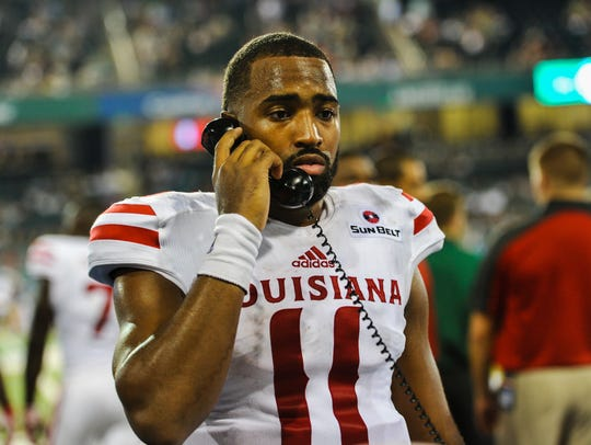 UL quarterback Anthony Jennings  on the phone during