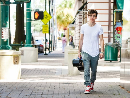 Mackenzie Bourg visits with Herman Fuselier to discuss