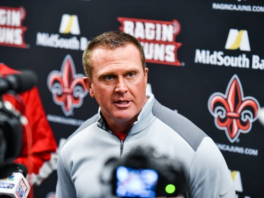 UL's Mark Hudspeth talks to reporters.