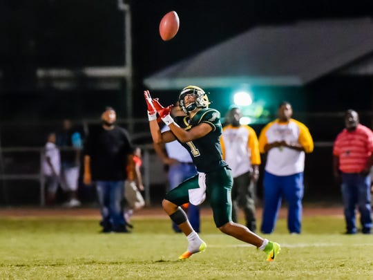 Bralen Trahan makes a catch as the Acadiana Rams host the Comeaux Spartans.