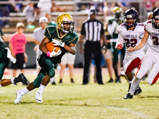 Jaylen James  takes the handoff from Quarterback Jaylon Borel as the Acadiana Rams host the Comeaux Spartans.