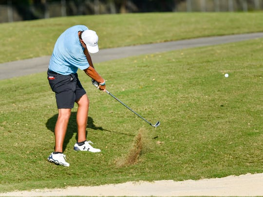 Ryan Desormeaux hits from near the bunker during the Lafayette City Golf Championship at The Wetlands Golf Course on Sunday.