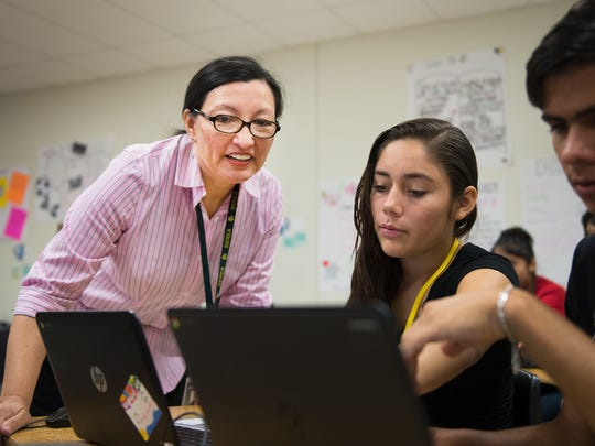 Dr. Blanca O'Connor helps students with an assignment during a newcomers program at Berea High School on Thursday, October 20, 2016.