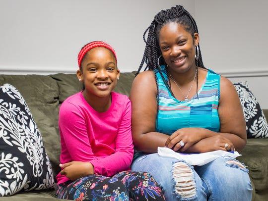 Debreka Handy and her daughter Ricala Jones visit with