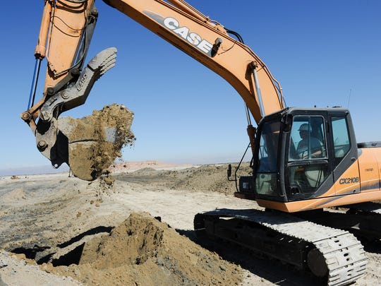 A worker uses an excavator in 2016 at Red Hill Bay near the shore of the Salton Sea, where 500 acres of ponds and wetlands are under construction.