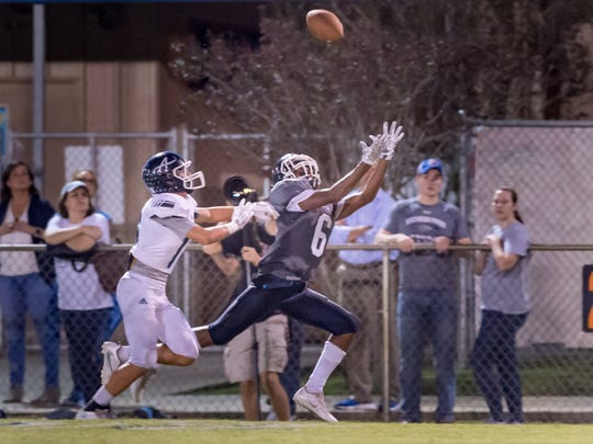 Errol Rogers Jr reaches for a pass as Lafayette Christian Academy host the Ascension Blue Gators. October 28, 2016.