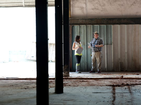 Lisa Marvel,who has been working on the Marvelous Market speaks with Daryl Bowers of Bowers Electric in her space at Hampton Station.