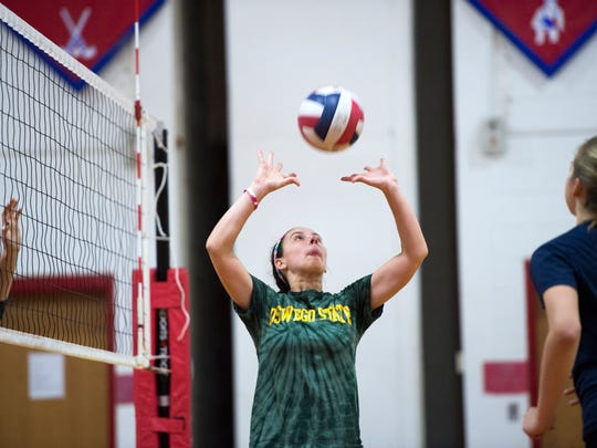 Owego sophomore Grace Thomas sets the ball Tuesday at practice. Thomas is in her first year as the Indians' setter.