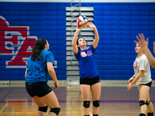 Owego senior Sarah Kies sets the ball during a practice Tuesday as the Indians prepare for the Class B state volleyball tournament at the Glens Falls Civic Center this weekend.