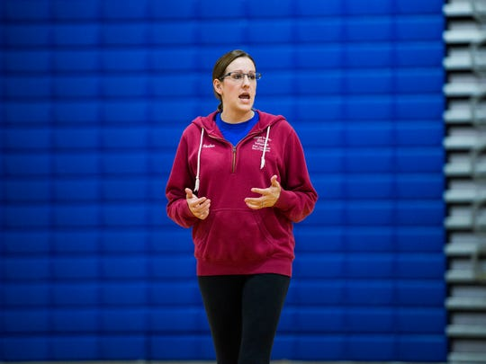 Owego volleyball coach Brittney Race addresses her team at practice in 2016. Race implemented many changes that have helped the Indians to the state tournament.
