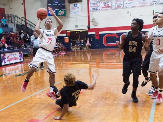 Braxton Stevens shoots for two as Comeaux takes on New Ideria Senior High. Tuesday, Jan. 3, 2017.