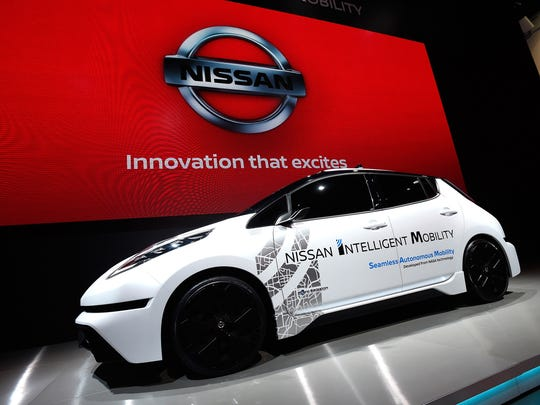 "A Nissan Leaf is displayed at CES 2017 at the Las Vegas Convention Center on January 5, 2017 in Las Vegas, Nevada. To accelerate the time it will take for autonomous vehicles to get on the road safely, Carlos Ghosn announced a breakthrough technology called ""Seamless Autonomous Mobility,"" or SAM. Developed from NASA technology, SAM partners in-vehicle artificial intelligence (AI) with human support to help autonomous vehicles make decisions in unpredictable situations and build the knowledge of in-vehicle AI. This technology could potentially enable millions of driverless cars to co-exist with human drivers in an accelerated timeline. It is part of Nissan Intelligent Integration."