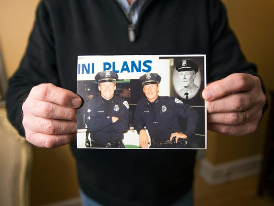 "Terrence Helsin holds a photo of him, left, and his brother Kevin, center, with a photo taken in of their father James ""Red"" Heslin superimposed."