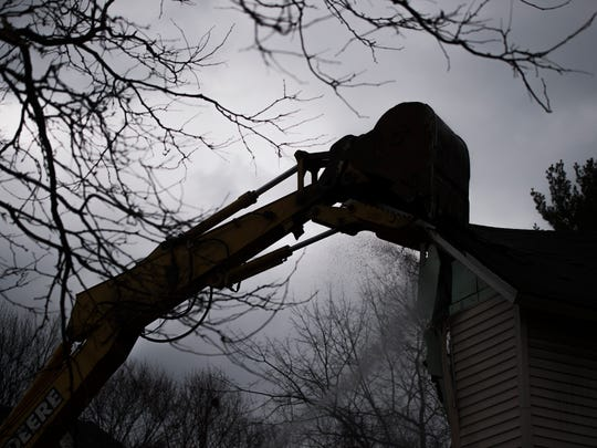 Crews demolish 110 Liberty St. in Binghamton on Thursday as part of an expansion project for the Lee Barta Community Center.