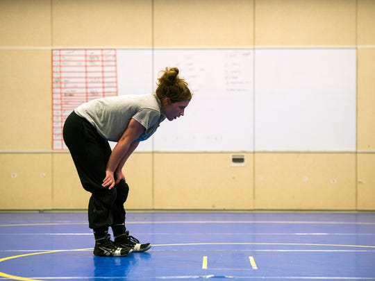 Maine-Endwell wrestler Cheyenne Sisenstein rests between drills during practice on Wednesday, February 8, 2017.
