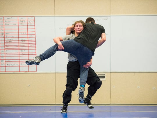 Maine-Endwell wrestler Cheyenne Sisenstein, right,