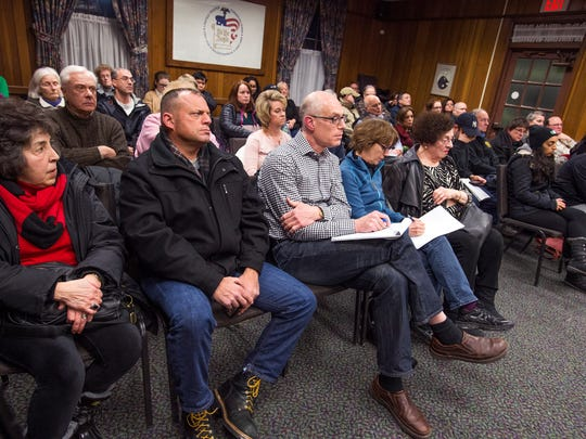 """Vestal residents listen to a plan to expand the Hayes Student Living project at Vestal Town Hall on Thursday. The board denied the project request calling it """"substantial""""."""