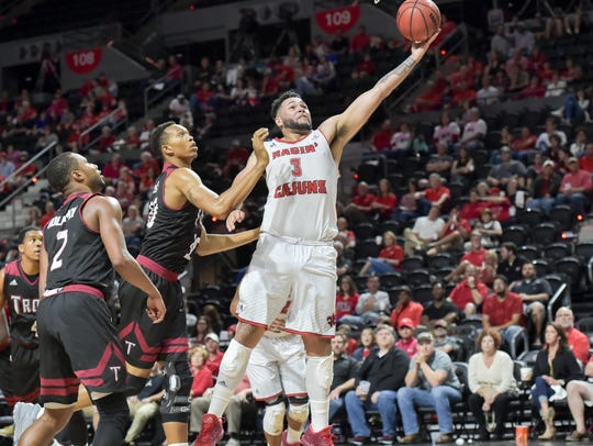 UL's Justin Miller takes the ball to the basket against