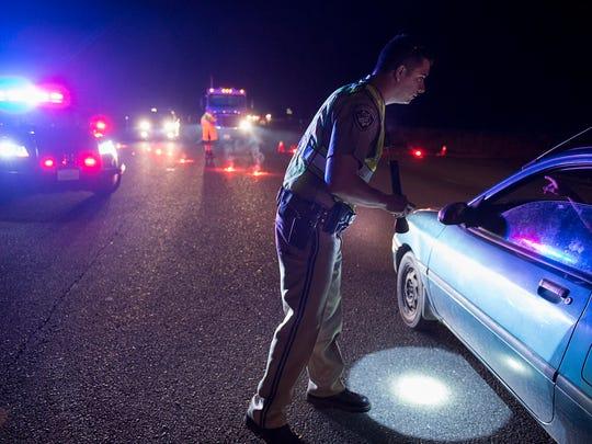 California Highway Patrol officer Ken Weckman directs