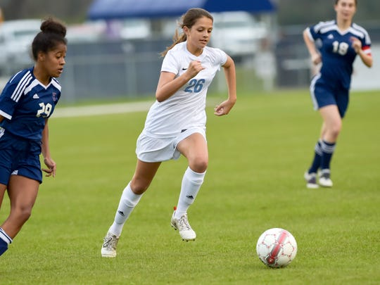 Emma Godwin drives the ball down field as Ascension