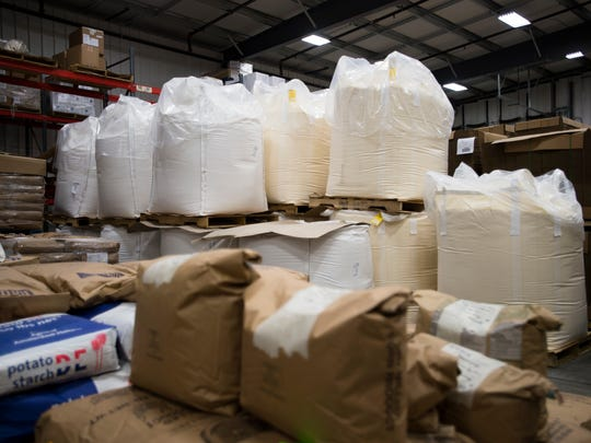 Bulk bags of corn meal in the Raymond-Hadley storage facility in Spencer. Cornmeal was among the first products offered by the baking supply company.
