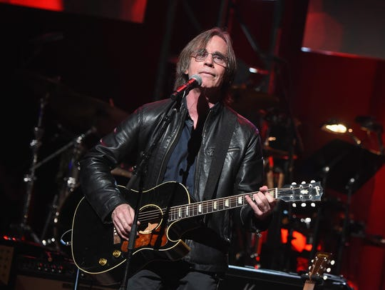 Jackson Browne performs during a benefit for charity