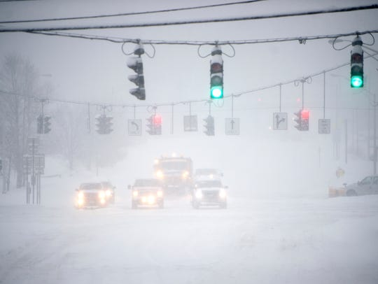 Cars wait for a light along the Vestal Parkway on Tuesday