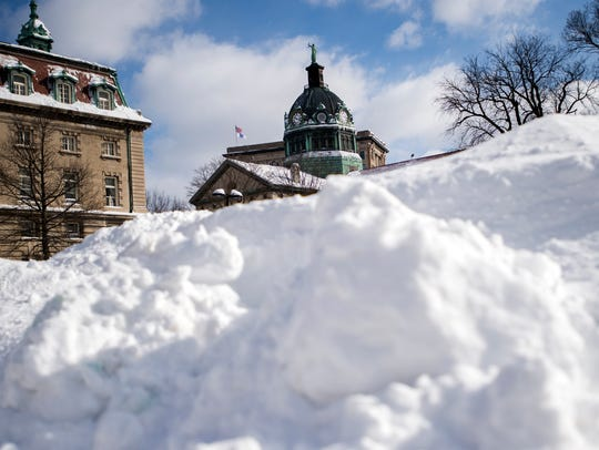 The Broome County Courthouse seen behind a pile of