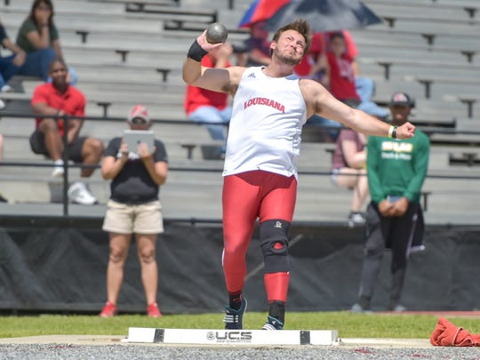 Spencer Nezat competes in the Mens shot put during