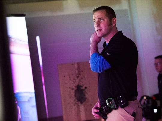 Binghamton Police patrolman Chris Governanti participates in a domestic disturbance simulation on Tuesday.