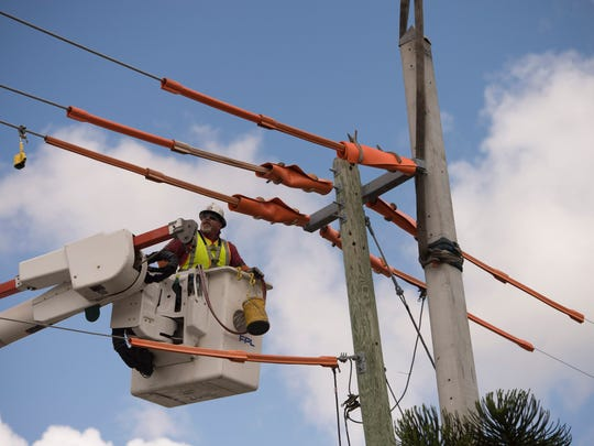 Florida Power & Light Company (FPL) field crews strengthen power lines by installing new utility poles designed to withstand winds of up to 145 mph, at 700 Flamingo Ave. on Thursday, March 30, 2017 in Stuart.