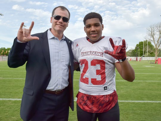 "Ex-Cajuns football player Ken Stansbury poses with Timothy ""T.J."" Cotton, a ninth-grader who is a cancer survivor and the son of late UL running back Kenyon Cotton."