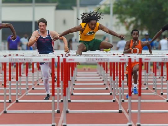 Terrell Chevalier wins the 100m hurdles at the Class 4A Regional Track and Field meet at Cajun Track Facility. Wednesday, April 26, 2017.
