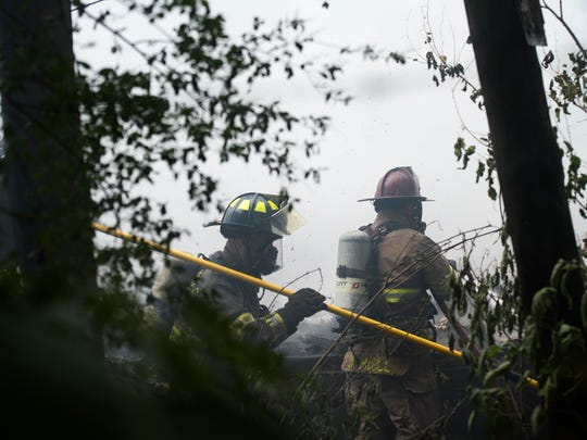 Centerville Volunteer Fire Department firefighters respond to a mobile home fire near Appleton and Whitner streets in Anderson on Tuesday, May 23, 2017.